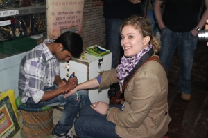 Natalie getting a henna tattoo.