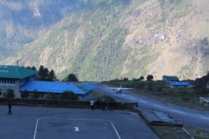 Plane taking off at Lukla - it's a sheer drop at the end of the runway!